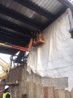Building Shrink Wrapping in New York City – providing coverage for new concrete and heat for the construction workers.